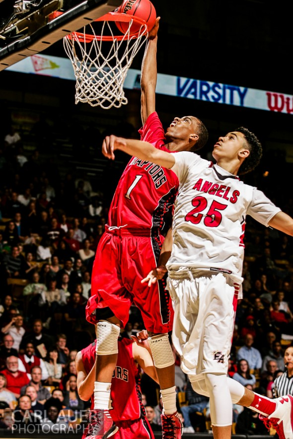 March 16th, 2013:  Eaglecrest Raptors senior forward Rayjon Craig (1) elevates for a dunk attempt over Denver East Angels junior guard Ronnie Harrell (25) in the 5A State Championship game at the Coors Events Center in Boulder, Colorado