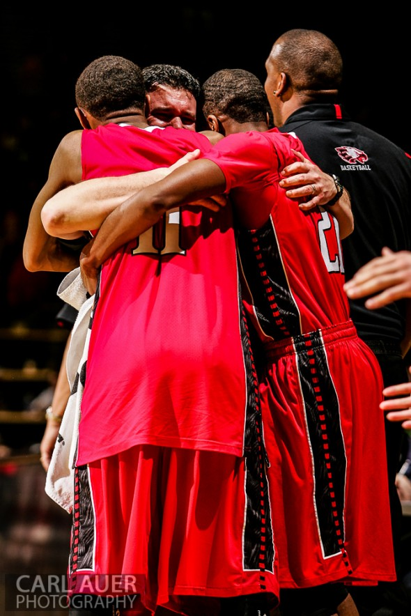 March 16th, 2013:  Eaglecrest Raptors head coach John Olander embraces junior guards LaDerian King (11) and Jaisean Jackson (21) as the Raptors defeat the Denver East Angels to win the 5A State Championship at the Coors Events Center in Boulder, Colorado