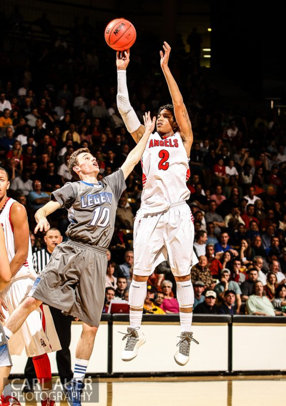 March 15, 2013: Denver East Angels junior guard Jevon Griffin (2) puts up a shot attempt over Legend Titans senior Joey Sloan (10) in the CHSAA 5A Final Four game at the Coors Events Center in Boulder, Colorado