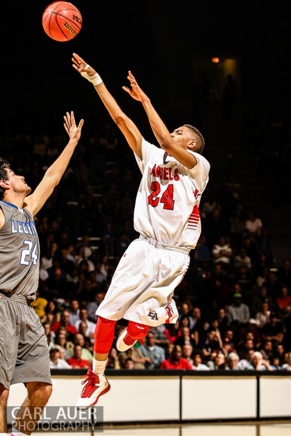 March 15, 2013: Denver East Angels junior guard Dominique Collier (24) puts up a shot attempt over Legend Titans senior Connor Orgill (24) in the CHSAA 5A Final Four game at the Coors Events Center in Boulder, Colorado