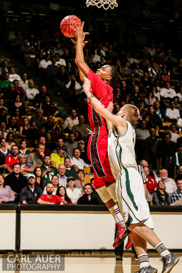 March 15th, 2013: Eaglecrest  Raptors senior forward Rayjon Craig (1) out jumps Mountain Vista Golden Eagles senior forward Chandler Wiscombe (2) for a rebound in the CHSAA 5A Final Four game at the Coors Events Center in Boulder, Colorado