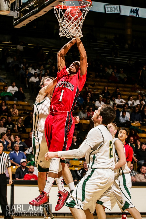 March 15th, 2013: Eaglecrest Raptors senior forward Rayjon Craig (1) attempts a shot between the Mountain Vista Golden Eagles defense in the CHSAA 5A Final Four game at the Coors Events Center in Boulder, Colorado