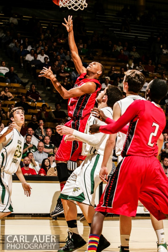 March 15th, 2013: Eaglecrest Raptors junior guard Jaisean Jackson (21) attempts a shot past the Mountain Vista Golden Eagles defense in the CHSAA 5A Final Four game at the Coors Events Center in Boulder, Colorado