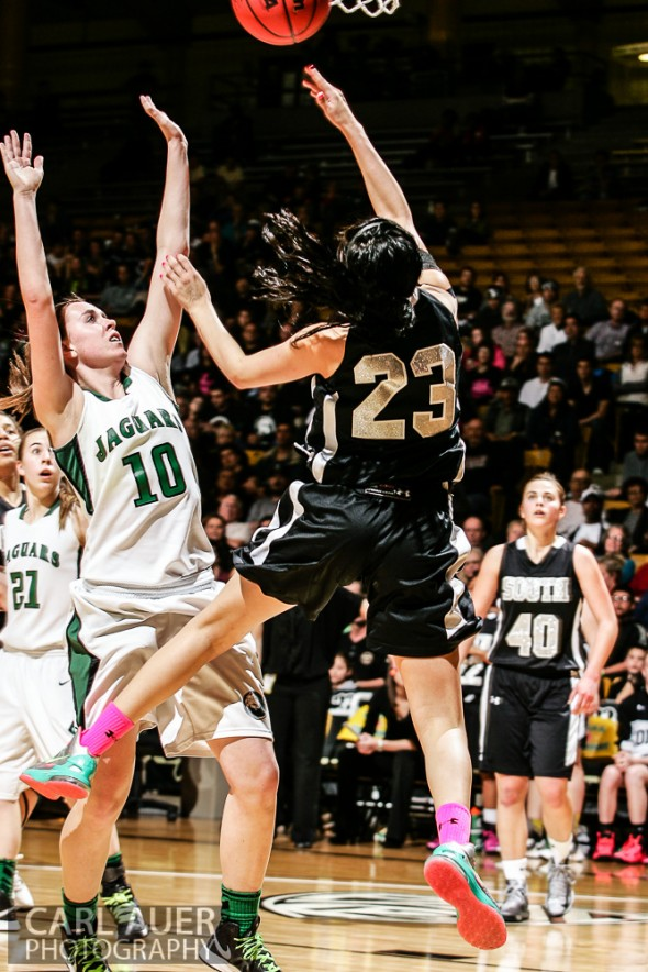 March 16th, 2013: Pueblo South Colts sophomore guard Jaylyn Duran (23) flips up a shot attempt past D'Evelyn Jaguars junior guard Katie Cunniff (10) flies between the Pueblo South defense in the Championship game of the CHSAA 4A State Tournament at the Coors Events Center in Boulder, Colorado