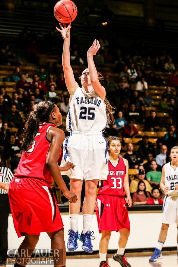 March 16th, 2013:  Highlands Ranch Falcons forward Kelsey Wainright (25) make a jump shot attempt over Regis Jesuit Raiders junior forward/center Diani Akigbogun (15) in the CHSAA 5A State Championship Final Game at the Coors Events Center in Boulder, Colorado