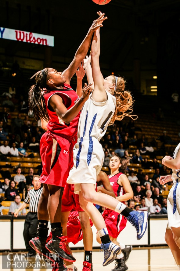 March 16th, 2013:  Highlands Ranch Falcons senior center Madison Montgomery (11) has her shot attempt blocked by Regis Jesuit Raiders junior forward/center Diani Akigbogun (15) in the CHSAA 5A State Championship Final Game at the Coors Events Center in Boulder, Colorado