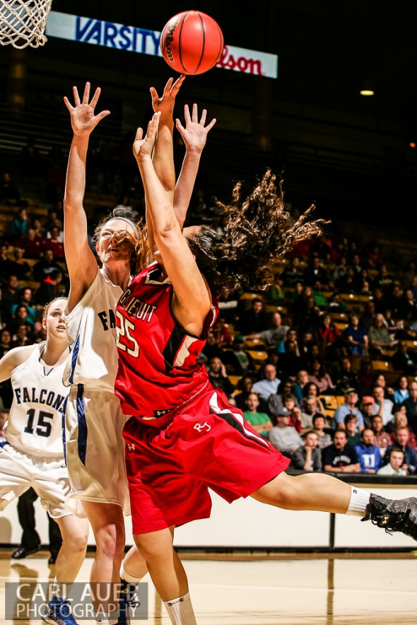 March 16th, 2013:  Regis Jesuit Raiders junior forward Kelsi Lidge (25) throws up a wild shot attempt against the Highlands Ranch Falcons defense in the CHSAA 5A State Championship Final Game at the Coors Events Center in Boulder, Colorado