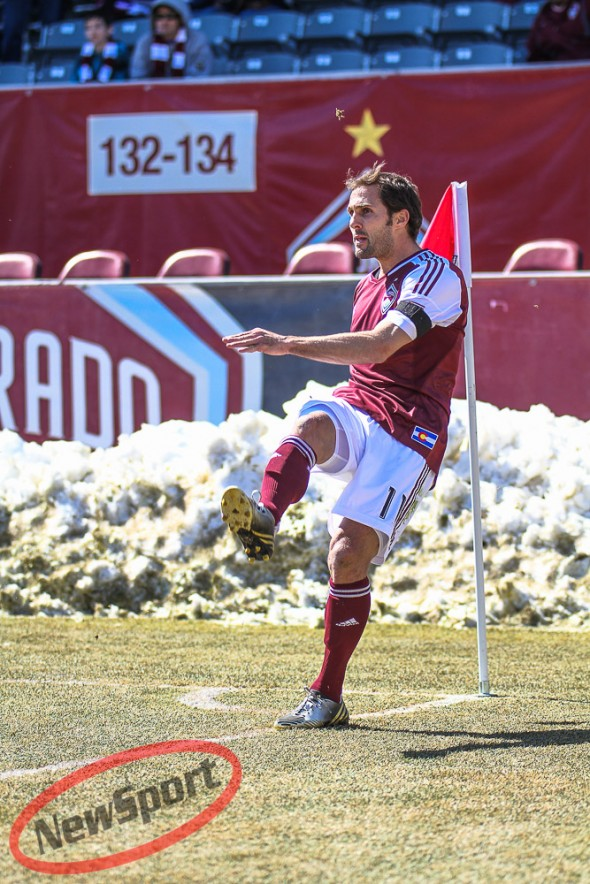 March 10th, 2013 Commerce City, CO - Colorado Rapids midfielder Brian Mullan (11) makes a corner kick pass in the first half of action of the MLS soccer game between the Philadelphia Union and the Colorado Rapids at Dick's Sporting Goods Park in Commerce City, CO