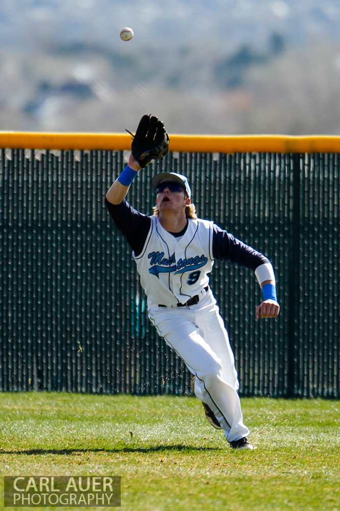 April 24th, 2013: The Ralston Valley Mustangs right fielder makes a catch in the game against Arvada West at Ralston Valley High School in Arvada, Colorado