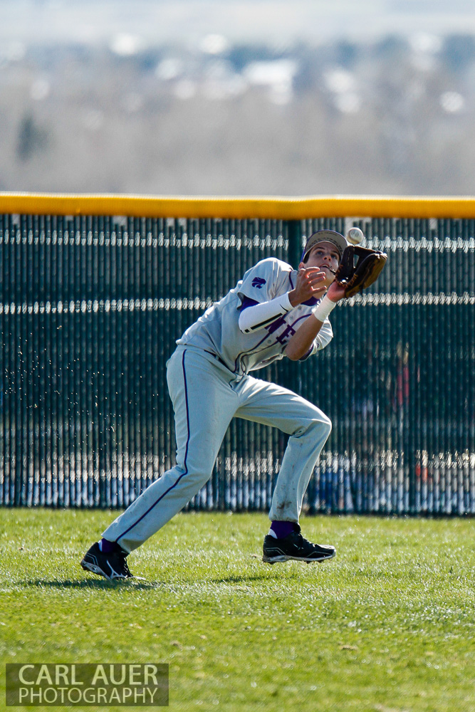 April 24th, 2013: The Arvada West right fielder makes a catch in the game against the Ralston Valley Mustangs at Ralston Valley High School in Arvada, Colorado