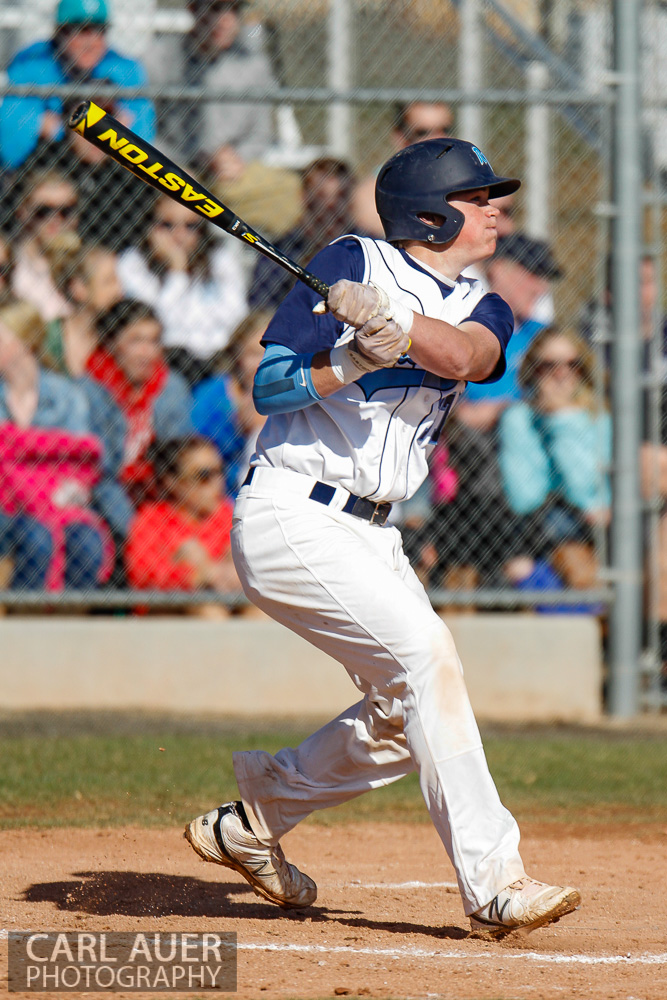 April 24th, 2013: A Ralston Valley Mustangs batter watches the ball he just hit in the game against Arvada West at Ralston Valley High School in Arvada, Colorado