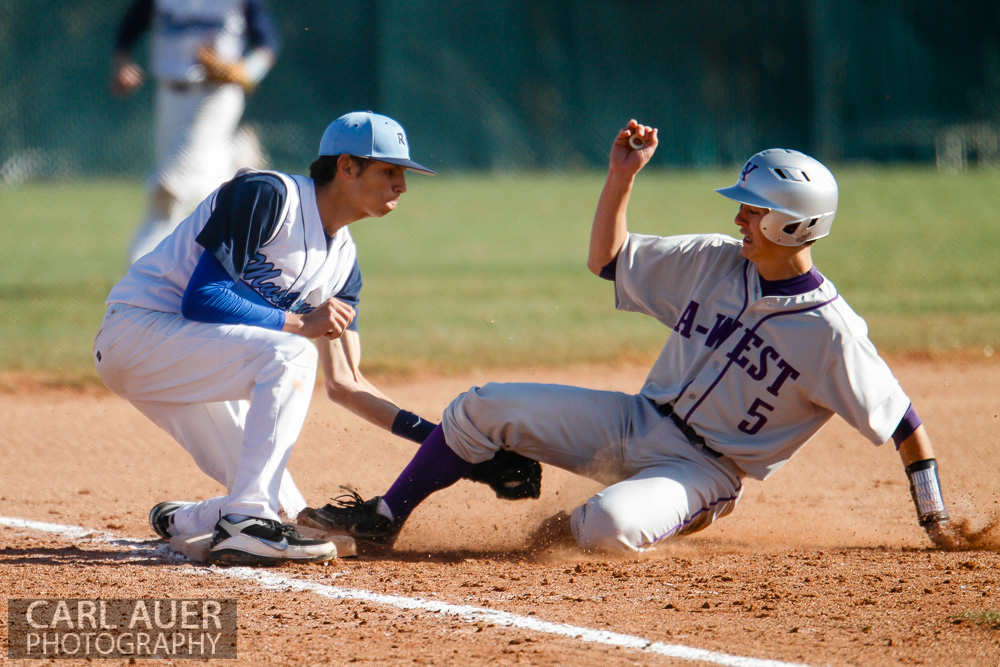 April 24th, 2013: The Ralston Valley Mustangs third baseman tags out the Arvada West baserunner in the game against Arvada West at Ralston Valley High School in Arvada, Colorado