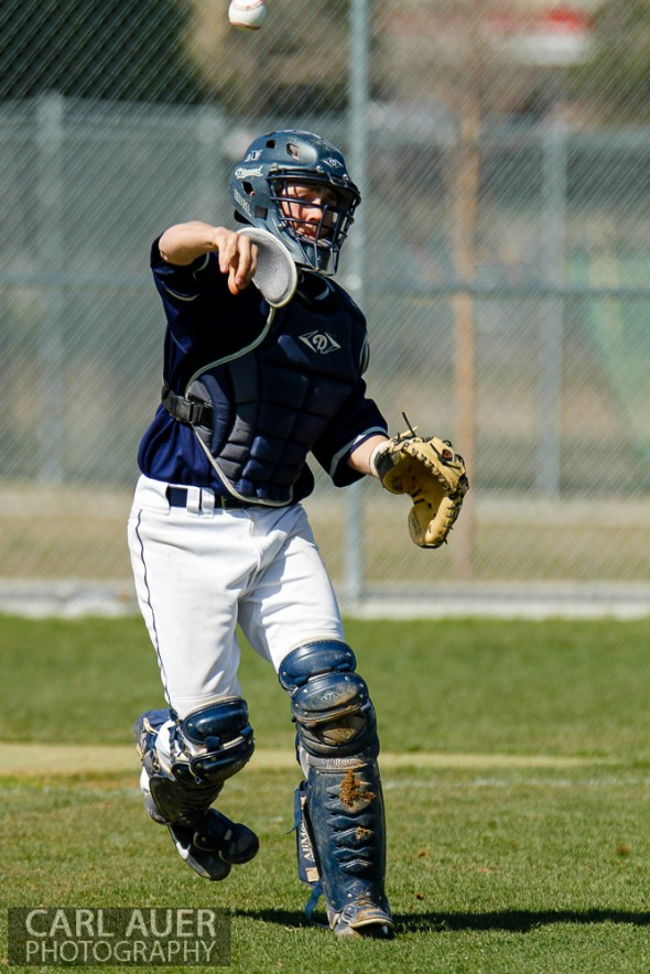 April 26th, 2013: The Columbine Rebel's catcher throws out a runner at first base in the away game against the Arvada West Wildcats at Arvada West High School in Arvada, Colorado