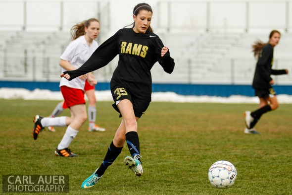 April 25th, 2013: Green Mountain Ram Shanna Grove (35) kicks the ball ahead of her in the game against the Arvada Bulldogs at the North Area Athletic Complex in Arvada, Colorado