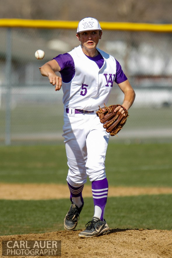 April 26th, 2013: Arvada West Wildcat pitcher Justin Mulvaney (5) attempts to pick a runner off at first base in the game against the Columbine Rebels at Arvada West High School in Arvada, Colorado