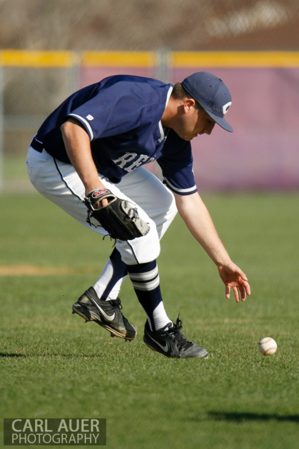 April 26th, 2013: Columbine Rebels pitcher Kyle Lopez (12) bare hands a ground ball in the league game against the Arvada West High School Wildcats in Arvada, Colorado