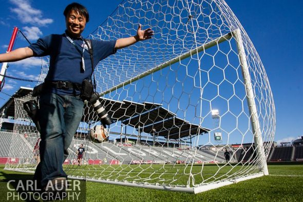 May 21, 2013: MaxPreps photographer Ray Chen walks past my remote camera behind the goal prior to the start of the Colorado 3A Girls High School Soccer Championship Game at Dick's Sporting Goods Park in Commerce City, Colorado