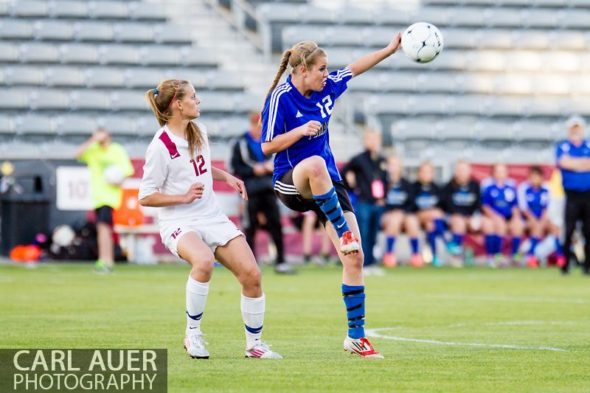 May 21, 2013: Peak to Peak Pumas senior midfielder Belle Morel (12) collects a pass in front of The Classical Academy Titans senior defender CheyAnn Queener (12) in the Colorado 3A Girls High School Soccer Championship Game at Dick's Sporting Goods Park in Commerce City, Colorado