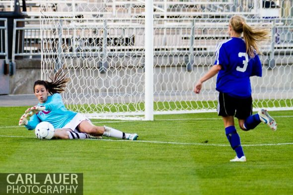 May 21, 2013: The Classical Academy Titans senior goalkeeper Claire LaValley (00) pounces on the ball in front of Peak to Peak Pumas sophomore midfielder Brianna Wetmore (3) in the Colorado 3A Girls High School Soccer Championship Game at Dick's Sporting Goods Park in Commerce City, Colorado