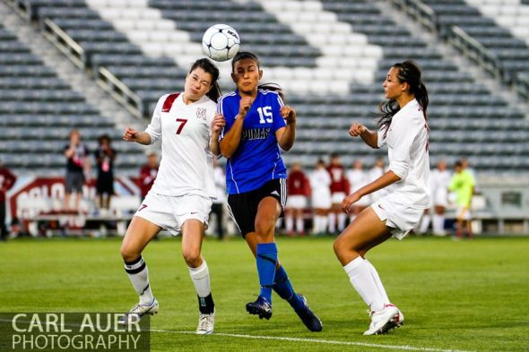 May 21, 2013: Peak to Peak Pumas senior midfielder Ivy Devries (15) and The Classical Academy Titans senior defender Sarah Turner (7) battle for control of the ball in the Colorado 3A Girls High School Soccer Championship Game at Dick's Sporting Goods Park in Commerce City, Colorado