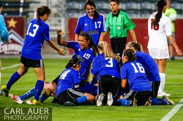 May 21, 2013: The Peak to Peak Pumas pile on top of each other after defeating The Classical Academy Titans 1-0 to capture the Colorado 3A Girls High School Soccer State Championship at Dick's Sporting Goods Park in Commerce City, Colorado