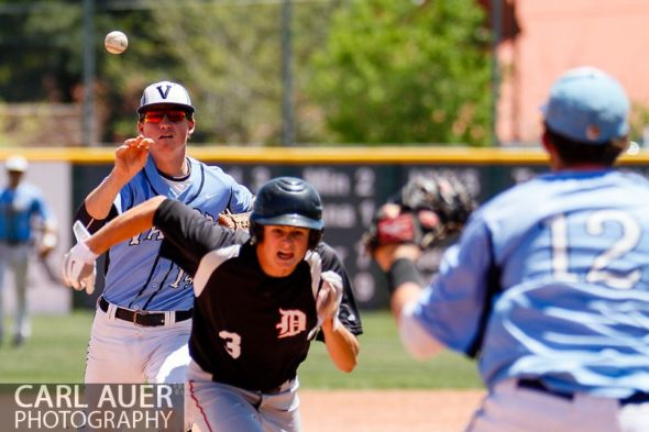 May 24, 2013 - Valor Christian senior second baseman Daniel Lund (14) tosses the ball to junior Kyle Robbins (12) as they get Durango Demons junior Blake Dunlap (3) trapped in a pickle during the CHSAA 4A Semi-Final game at All-Star Park in Lakewood, Colorado