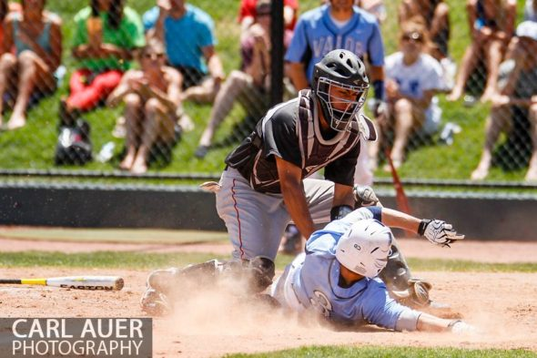 May 24, 2013 - Durango Demons junior catcher Isiah Mayberry (15) tags out Valor Christian senior Greg Popylisen (3) in a play at the plate in the CHSAA 4A Semi-Final game at All-Star Park in Lakewood, Colorado