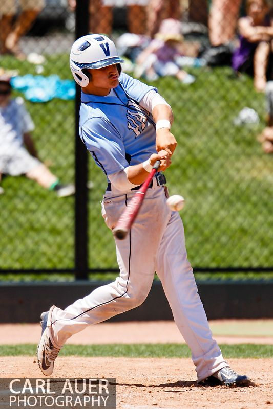May 24, 2013 - Valor Christian junior Justin Falls (5) connects with a pitch against the Durango Demons in the CHSAA 4A Semi-Final game at All-Star Park in Lakewood, Colorado