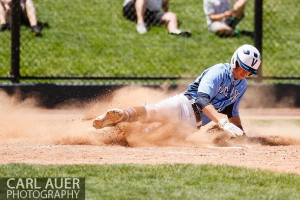 May 24, 2013 - Valor Christian senior Daniel Lund (14) slides across home plate against the Durango Demons in the CHSAA 4A Semi-Final game at All-Star Park in Lakewood, Colorado