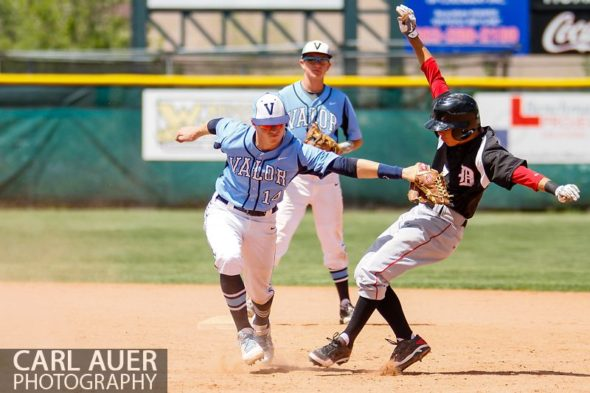 May 24, 2013 - Valor Christian senior second baseman Daniel Lund (14) tags out Durango Demons junior Sean Blanchard (7) in the CHSAA 4A Semi-Final game at All-Star Park in Lakewood, Colorado