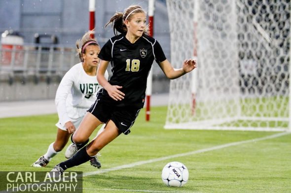 May 22, 2013 - Rock Canyon Jaguars junior Emily Postma (18) keeps the ball in bounds and away from Mountain Vista Golden Eagle freshman Mallory Pugh (9) in the Colorado 5A State Championship game at Dick's Sporting Goods Park in Commerce City, CO