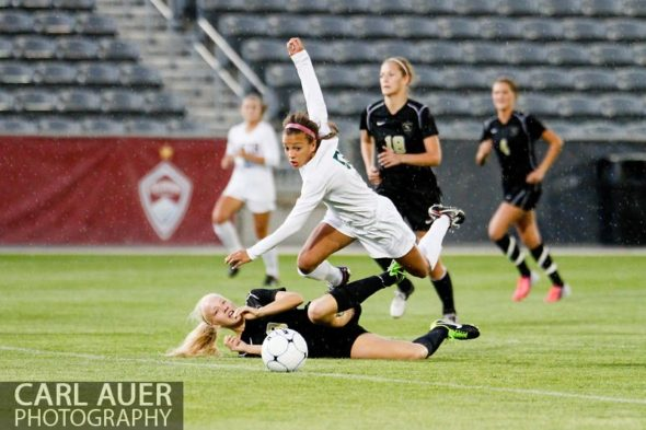 May 22, 2013 - Mountain Vista Golden Eagle freshman Mallory Pugh (9) is tripped up by Rock Canyon Jaguars senior Makayla McBride (8) in the Colorado 5A State Championship game at Dick's Sporting Goods Park in Commerce City, CO