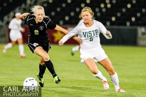 May 22, 2013 - Rock Canyon Jaguars senior Makayla McBride (8) and Mountain Vista Golden Eagle sophomore Amy Alexander (5) chase after the ball in the Colorado 5A State Championship game at Dick's Sporting Goods Park in Commerce City, CO