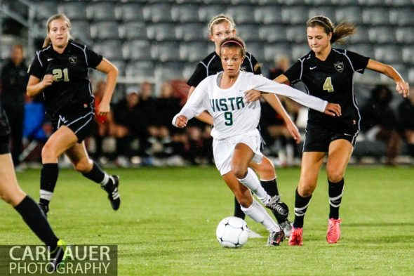 May 22, 2013 - Mountain Vista Golden Eagle freshman Mallory Pugh (9) brings the ball down the pitch against the defense by Rock Canyon Jaguars sophomore Allie Riggs (4) in the Colorado 5A State Championship game at Dick's Sporting Goods Park in Commerce City, CO