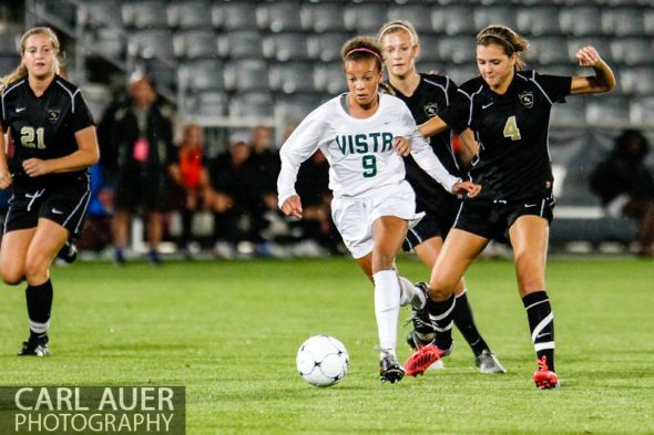 May 22, 2013 - Mountain Vista Golden Eagle freshman Mallory Pugh (9) breaks away from Rock Canyon Jaguars sophomore Allie Riggs (4) in the Colorado 5A State Championship game at Dick's Sporting Goods Park in Commerce City, CO
