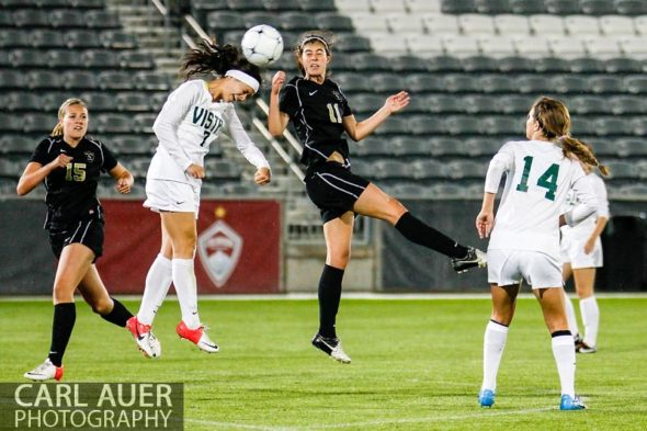 May 22, 2013 - Mountain Vista Golden Eagle senior Gabbi Miranda (7) and Rock Canyon Jaguars junior Kaycie Young (11) both elevate to head the ball in the Colorado 5A State Championship game at Dick's Sporting Goods Park in Commerce City, CO