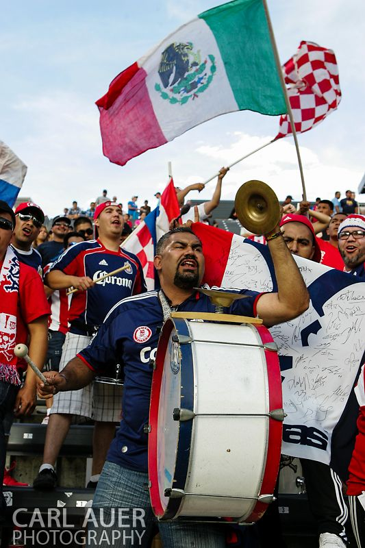 May 25th, 2013 Commerce City, CO - A Chivas USA fan bangs a drum as his team takes the field before the start of action in the MLS match between Chivas USA and the Colorado Rapids at Dick's Sporting Goods Park in Commerce City, CO