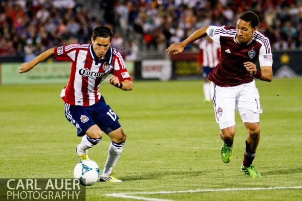 May 25th, 2013 - Chivas USA midfielder Eric Avila (15) brings the ball towards the goal against Colorado Rapids defender Chris Klute (15) in the second half of the MLS match between Chivas USA and the Colorado Rapids at Dick's Sporting Goods Park in Commerce City, CO