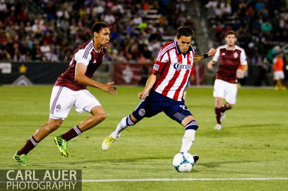 May 25th, 2013 - Chivas USA midfielder Eric Avila (15) attempts a shot past Colorado Rapids defender Chris Klute (15) in the second half of the MLS match between Chivas USA and the Colorado Rapids at Dick's Sporting Goods Park in Commerce City, CO