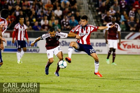 May 25th, 2013 - Chivas USA midfielder Carlos Alvarez (20) and Colorado Rapids midfielder Nick LaBrocca (2) fight for control of the ball in the second half of the MLS match between Chivas USA and the Colorado Rapids at Dick's Sporting Goods Park in Commerce City, CO