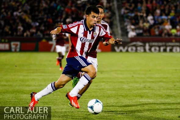 May 25th, 2013 - Chivas USA midfielder Carlos Alvarez (20) breaks towards the goal with the ball in the second half of action in the MLS match between Chivas USA and the Colorado Rapids at Dick's Sporting Goods Park in Commerce City, CO