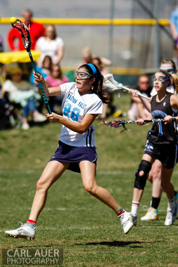 April 27th, 2013: Ralston Valley Mustangs freshman Olivia Sandoval (28) launches a shot at the Grandview Wolves goal in the game at Ralston Valley High School on Saturday morning in Arvada, Colorado