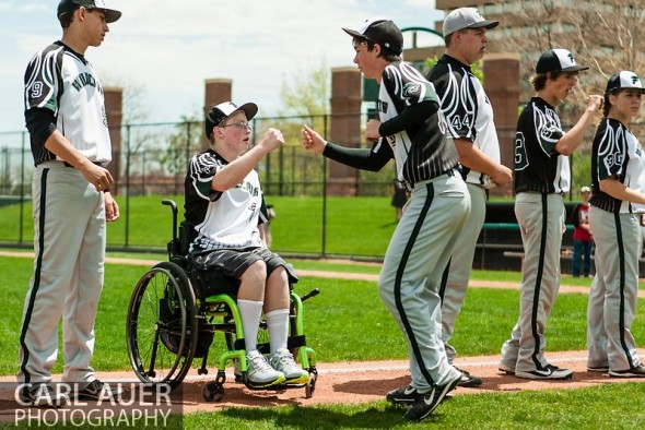 May 17th 2013: Fleming Wildcats senior Jeremy Richhard-Kind (7) fist bumps a teammate during pre game introductions of the CHSAA 1A Baseball final against the Holly Wildcats at All Star Park in Lakewood, Colorado