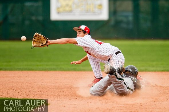 May 17th 2013: Fleming Wildcats senior pitcher Tyler Vandenbark (23) slides head first into second base on the steal in the CHSAA 1A Baseball final against the Holly Wildcats at All Star Park in Lakewood, Colorado
