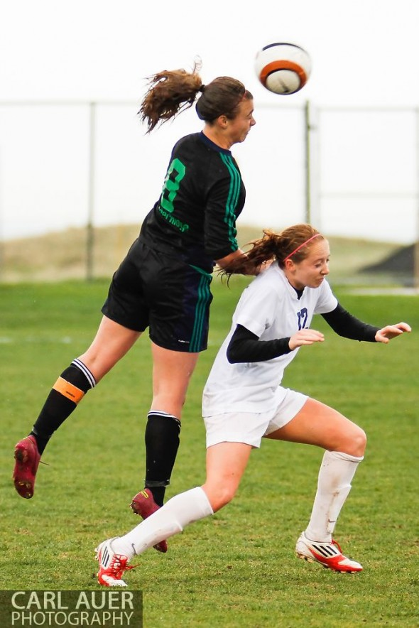 May 8th, 2013: ThunderRidge Grizzlies sophomore Katie Desch (8) jumps over Ralston Valley Mustang sophomore Sam Bedenger (12) to head the ball in the CHSAA 5A Soccer Playoff game at the North Area Athletic Complex in Arvada, Colorado
