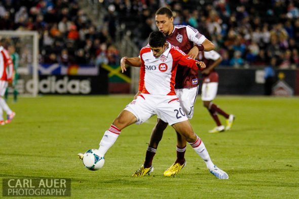 May 4th, 2013 - Toronto FC midfielder Matías Laba (20) attempts to keep Colorado Rapids defender Chris Klute (15) away from the ball in action during the MLS match between the Toronto FC and the Colorado Rapids at Dick's Sporting Goods Park in Commerce City, CO