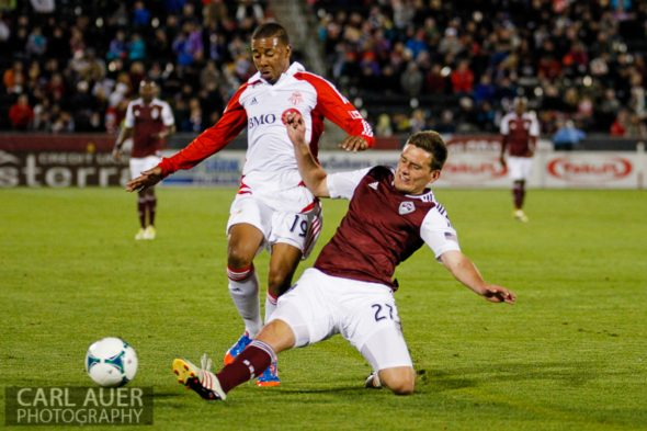 May 4th, 2013 - Colorado Rapids midfielder Shane O'Neill (27) kicks the ball away from Toronto FC midfielder Reggie Lambe (19) in the second half of the MLS match between the Toronto FC and the Colorado Rapids at Dick's Sporting Goods Park in Commerce City, CO