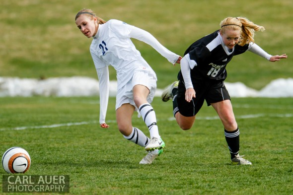 May 3rd, 2013: Ralston Valley Mustangs sophomore midfielder Nicholle Knopp (11) and a Pomona Panthers player fight for control of the ball in their game at the North Area Athletic Complex in Arvada, Colorado