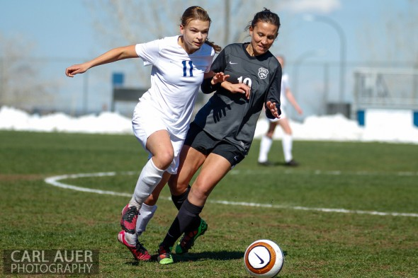 May 2nd, 2013: Ralston Valley Mustang senior midfielder Sierra Cymes (11) and D'Evelyn Jaguars senior Kendall MacCagnan (19) battle for the ball in the game at the North Area Athletic Complex in Arvada, Colorado