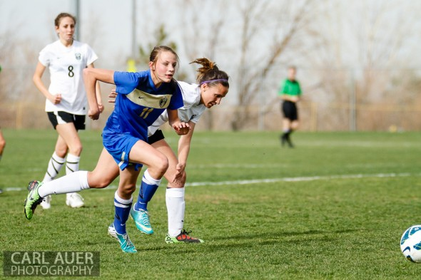 April 29th, 2013:  Wheat Ridge Farmers freshman forward Susan Whitney (11) outruns the D'Evelyn Jaguars defense after the ball in the game at the North Area Athletic Complex in Arvada, Colorado
